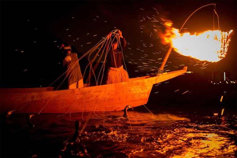 Pescadores Ukai de noite