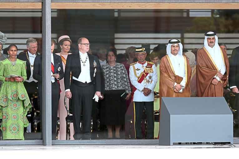 Líderes mundiais assistindo a cerimônia