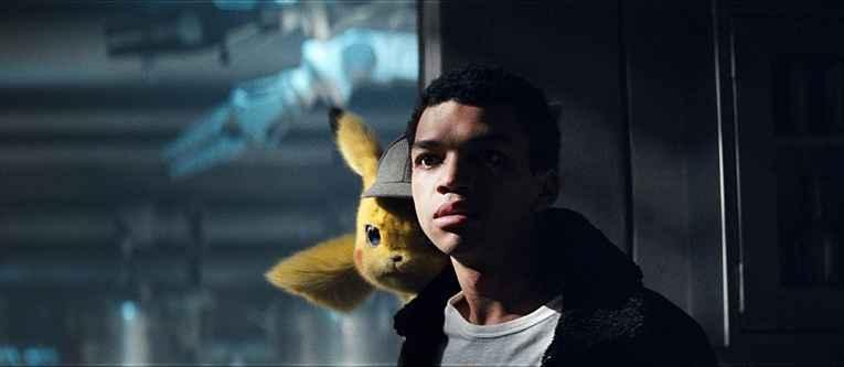 Tim com o detetive pikachu em seu ombro
